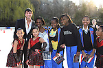 Olympic Skater Evan Lysacek poses with skaters at the Figure Skating in Harlem  - the 2011 Skating with the Stars on April 4, 2011 at Wollman Rink, Central Park, New York City, New York. (Photo by Sue Coflin/Max Photos)