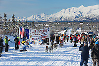 Dakota Schlosser leaves the start line during the 2015 Junior Iditarod start  on the Denali Highway on on Sunday March 1, 2015.  <br /> <br /> <br /> <br /> (C) Jeff Schultz/SchultzPhoto.com - ALL RIGHTS RESERVED<br />  DUPLICATION  PROHIBITED  WITHOUT  PERMISSION