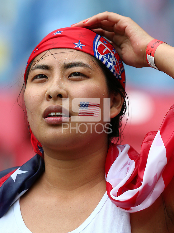 A USA fan looks on before kick off