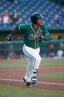 Isael Soto (15) of the Greensboro Grasshoppers hustles down the first base line against the Augusta GreenJackets at First National Bank Field on April 10, 2018 in Greensboro, North Carolina.  The GreenJackets defeated the Grasshoppers 5-0.  (Brian Westerholt/Four Seam Images)