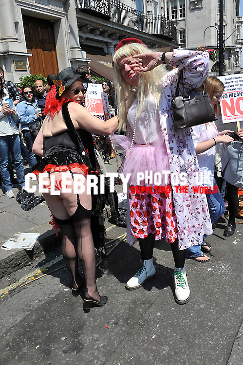 Thousands of women took part in Slut Walk in London insisting that they have the right to wear as much or as little as they like without facing sexual harassment by men