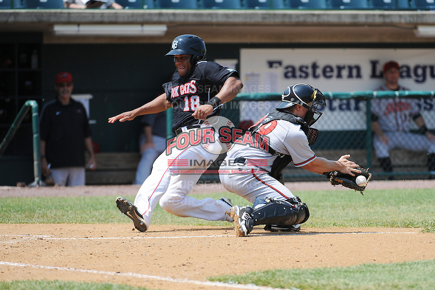 New Britain Rock Cats infielder Curt Smith (18) scores a run while Richmond Flying Squirrels catcher Brad Moss (49) tries to tag Curt Smith out during game played at New Britain Stadium on May 30, 2013 in New Britain, CT.  New Britain defeated Richmond 2-1.  (Tomasso DeRosa/Four Seam Images)