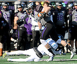 SIOUX FALLS, SD - NOVEMBER 8: Brady Rose #5 from the University of Sioux Falls is tripped up by Javon Moore #5 from Upper Iowa in the first quarter of their game Saturday afternoon at Bob Young Field in Sioux Falls.  (Photo by Dave Eggen/Inertia)