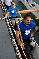Saturday, 01/24/09.  Campland on the Bay, Mission Bay, San Diego, CA, USA.  Ariel Rigney and Greg Crouse get ready to cast off for a paddle in an outrigger canoe on Mission Bay during an event sponsored by the Challenged Athletes Foundation.  The participants had the opportunity to try several different paddle sports.  The Challenged Athletes Foundation established the Operation Rebound fund to provide sports opportunities and support for troops, veterans and first responders who have suffered permanent physical injuries in the line of duty.
