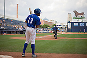 Ray Olmedo watches a play while on deck during home game on June 4, 2009.