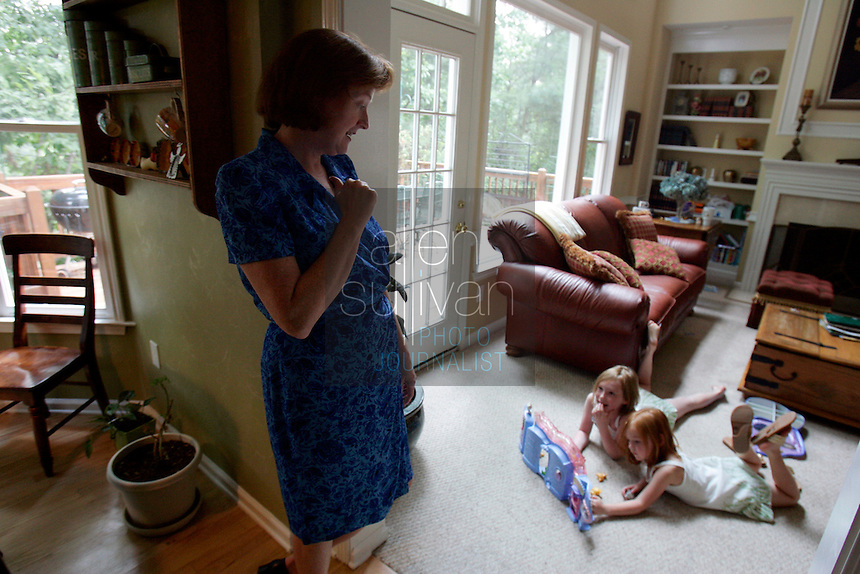 Anna Marie Wood watches her daughters Abigayle Wood (right), 5, and Caroline, 8, play at home in Lawrenceville, Ga. on Sunday, Sept. 10, 2006. Abigayle was born on Sept. 11, 2001. Wood said the attacks on that day caused her to go into early labor.<br />