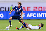 Takashi Inui of Japan (L) controls the ball as Javokhir Sidikov of Uzbekistan (R) gets tripped during the AFC Asian Cup UAE 2019 Group F match between Japan (JPN) and Uzbekistan (UZB) at Khalifa Bin Zayed Stadium on 17 January 2019 in Al Ain, United Arab Emirates. Photo by Marcio Rodrigo Machado / Power Sport Images