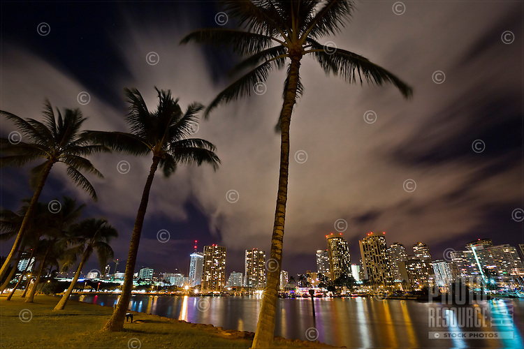 Waikiki at night, with the Ala Wai Canal in the foreground, Honolulu, O'ahu.