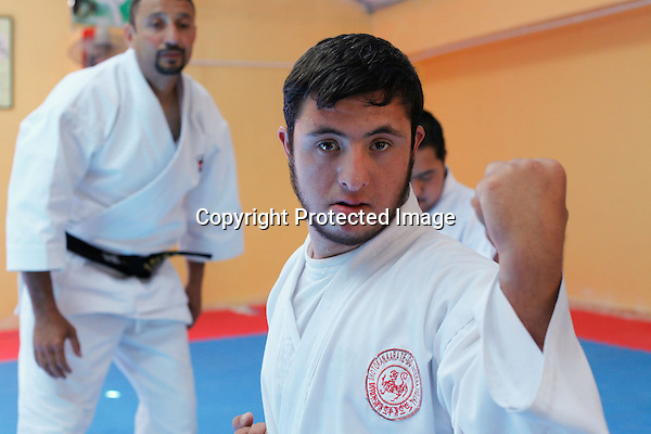 Karate coach Hosam Ayyad trains Karate to children suffering from various physical and mental challenges at a club in Amman, Jordan on July 08, 2010. Award-winning coach helps special needs children fight stigma. (Salah Malkawi for The National)