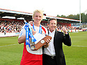 Mark Roberts of Stevenage Borough and chairman  Phil Wallace celebrate with the Blue Square Premier championship trophy after the Blue Square Premier match between Stevenage Borough and York City at the Lamex Stadium, Broadhall Way, Stevenage on Saturday 24th April, 2010..© Kevin Coleman 2010 ..