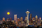 Full moon rising over Seattle Skyline at Twillight