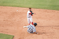 Mesa Solar Sox second baseman Esteban Quiroz (2), of the Boston Red Sox organization, throws to first base to try to complete a double play as Joe McCarthy (21) slides into second base during an Arizona Fall League game against the Peoria Javelinas at Sloan Park on October 11, 2018 in Mesa, Arizona. Mesa defeated Peoria 10-9. (Zachary Lucy/Four Seam Images)