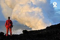 Woman watching lava flowing to the sea (Licence this image exclusively with Getty: http://www.gettyimages.com/detail/84430552 )