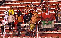 LA PAZ - BOLIVIA - 09 - 03 - 2017: Los hinchas de Independiente Santa Fe de Colombia, animan a su equipo, durante partido entre The Strongest de Bolivia y el Independiente Santa Fe de Colombia, por la fase de grupos del grupo 2 de la fecha 1 por la Copa Conmebol Libertadores Bridgestone en el estadio Hernando Siles Suazo, de la ciudad de La Paz. / Fans of Independiente Santa Fe of Colombia, cheer for their team during a match between The Strongest of Bolivia and Independiente Santa Fe of Colombia for the group stage, group 2 of the date 1 for the Conmebol Libertadores Bridgestone in the Hernando Siles Suazo Stadium in La Paz city. Photos: VizzorImage / Javier Mamani / APG / Cont.