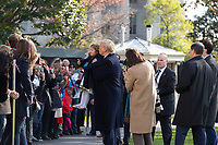 United States President Donald J. Trump kisses a young girl while taking a photo with her on the South Lawn of the White House in Washington D.C., U.S. as he departs for a day trip to Marietta, Georgia on Friday, November 8, 2019.  Credit: Stefani Reynolds / CNP /MediaPunch