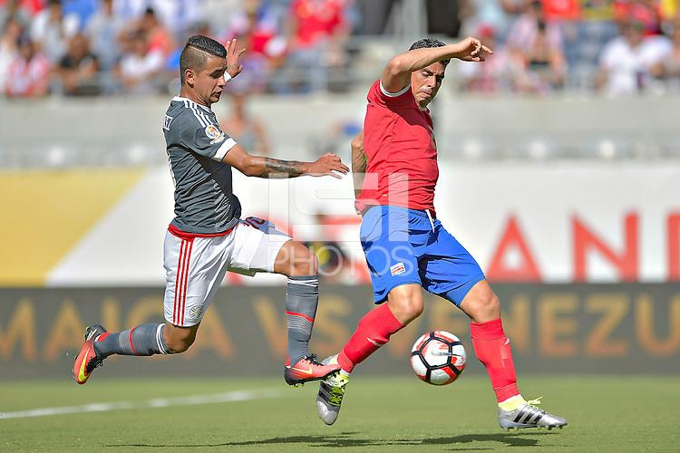 Action photo during the match Costa Rica vs Paraguay, Corresponding Group -A- America Cup Centenary 2016, at Citrus Bowl Stadium<br /> <br /> Foto de accion durante el partido Estados Unidos vs Colombia, Correspondiante al Grupo -A-  de la Copa America Centenario USA 2016 en el Estadio Citrus Bowl, en la foto: (i-d) Derlis Gonzalez de Paraguay  y  Johnny Acosta de Costa Rica<br /> <br /> <br /> <br /> 04/06/2016/MEXSPORT/Isaac Ortiz.