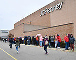 Shoppers walk to the end of the line outside the JC Penney's store at the St. Clair Square mall in Fairview Heights. Shoppers looking for bargains and discounted items endured a light but steady rain on Thanksgiving Day as they waited for stores to open in Fairview Heights, IL on November 28, 2019.<br />  Photo by Tim Vizer
