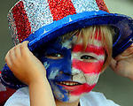 Andrew Szemreylo, 4, of Tolland, adds the hat to top  off his red, white and blue appearance, prior to the ten annual  Push, Pedal, Pull Patriotic Parade in downtown Rockville, part of the Vernon's July in the Sky celebration, Thursday, June 30, 2011. (Jim Michaud/Journal Inquirer)