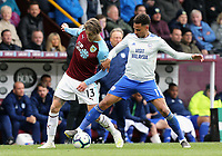 Burnley's Jeff Hendrick vies for possession with Cardiff City's Josh Murphy<br /> <br /> Photographer Rich Linley/CameraSport<br /> <br /> The Premier League - Saturday 13th April 2019 - Burnley v Cardiff City - Turf Moor - Burnley<br /> <br /> World Copyright © 2019 CameraSport. All rights reserved. 43 Linden Ave. Countesthorpe. Leicester. England. LE8 5PG - Tel: +44 (0) 116 277 4147 - admin@camerasport.com - www.camerasport.com