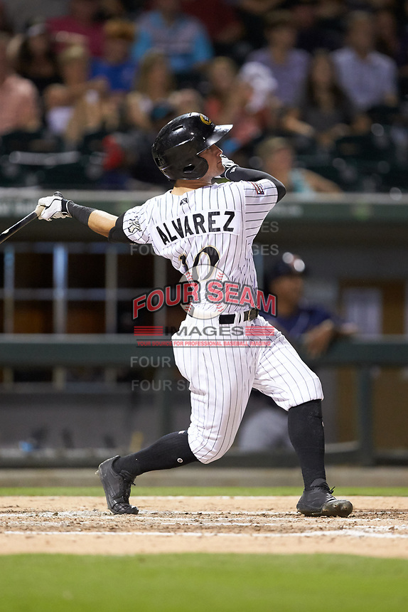 Eddy Alvarez (10) of the Charlotte Knights follows through on his swing against the Toledo Mud Hens at BB&T BallPark on June 22, 2018 in Charlotte, North Carolina. The Mud Hens defeated the Knights 4-0.  (Brian Westerholt/Four Seam Images)
