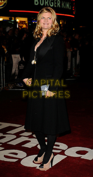 "SUSANNAH CONSTANTINE.World Premiere of ""The Damned United"" at the Vue West End, Leicester Square, London, England..March 18th 2009.full length black coat pink cream shoes platforms beige tights.CAP/CAN.©Can Nguyen/Capital Pictures."