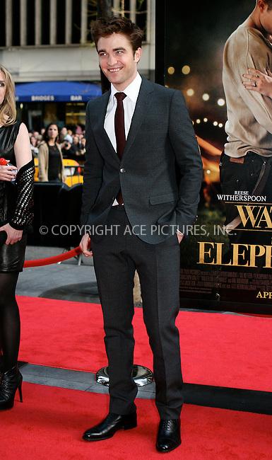 WWW.ACEPIXS.COM . . . . .  ....April 17 2011, New York City....Actor Robert Pattinson arriving at the 'Water For Elephants' premiere at the Ziegfeld Theatre on April 17, 2011 in New York City.....Please byline: NANCY RIVERA- ACEPIXS.COM.... *** ***..Ace Pictures, Inc:  ..Tel: 646 769 0430..e-mail: info@acepixs.com..web: http://www.acepixs.com