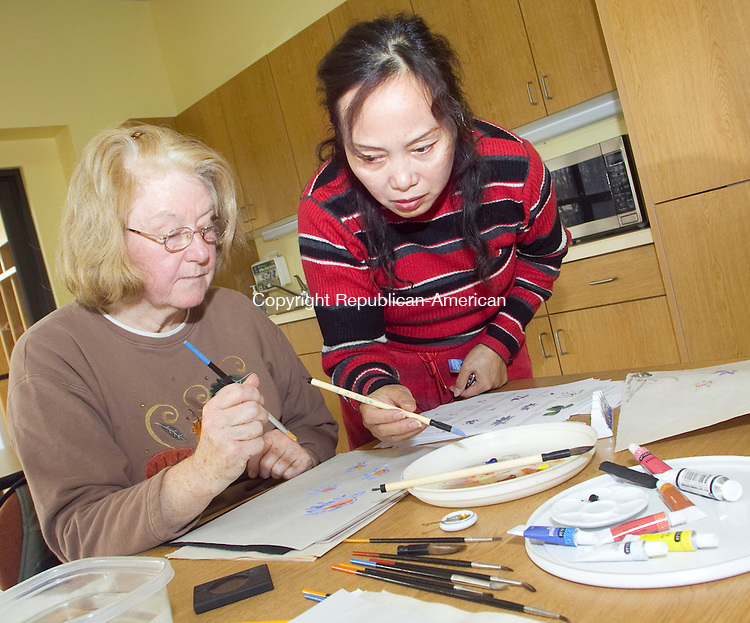 LITCHFEILD CT.-09 NOVEMBER 2010 110910DA02-  Chinese Language and Art Teacher Manli Luo right, instructs Marilyn Miller of Goshen during a Chinese Brush Painting class held at the Litchfield Community Center on Tuesday. Luo a native of China has been teaching for over twenty years to concentrate on the internal conditions of the heart and mind that has been the basis of the greatest works of Chinese art throughout history. If interested in class contact Manli Luo at 860-747-5380. No drawing or art skills are needed.<br /> Darlene Douty Republican-American