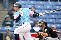 May 3, 2009:  Josh Petersen of the Binghamton Mets, Eastern League Class-AA affiliate of the New York Mets, follows through on a hit during a game at the NYSEG Stadium in Binghamton, NY.  The Mets wore special blue and pink jerseys that were auctioned off after the game to benefit breast and prostate cancer.  Photo by:  Mike Janes/Four Seam Images