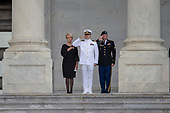 Cindy McCain and her sons Jack, center, and jimmy, right, stand at attention as a United States Military Honor Guard carries the casket of former Senator John McCain, Republican of Arizona, up the stairs of the Capitol in Washington, DC on August 31, 2018 in Washington, DC. McCain, a United States Military veteran and longtime Senator, will lay in state inside the Capitol Rotunda for one day prior to being laid to rest on September 1, 2018 at the United States Naval Academy in Annapolis, Maryland. Credit: Alex Edelman / CNP