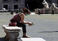 fA girl reads a book in Piazza Navona in central Rome on May 4, 2020 as Italy starts to ease its lockdown, during the countrys lockdown aimed at curbing the spread of the COVID-19 infection, caused by the novel coronavirus.<br /> UPDATE IMAGES PRESS/Isabella Bonotto
