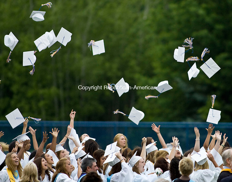 SEYMOUR, CT - 16 JUNE 2010 -061610JT06-<br /> Seymour High School graduates throw their mortarboards in the air at the end of Wednesday's graduation ceremonies at the school.<br /> Josalee Thrift Republican-American