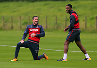 Pictured L-R: Gylfi Sigurdsson stretches with Leroy Fer. Tuesday 11 July 2017<br /> Re: Swansea City FC training at Fairwood training ground, UK