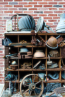 A collection of salvaged artefacts on metal shelves outside the atelier