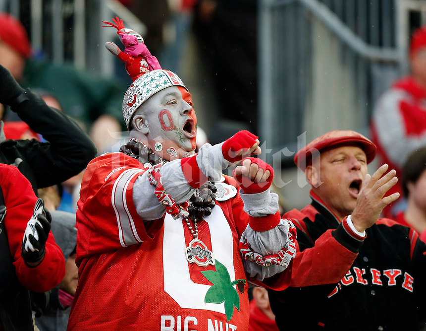 "Ohio State fan Jon Peters, a.k.a. ""Big Nut,"" cheers on the Buckeyes during the NCAA football game against the Rutgers Scarlet Knights at Ohio Stadium in Columbus on Oct. 18, 2014. (Adam Cairns / The Columbus Dispatch)"