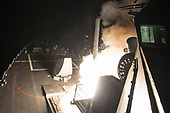 In this photo released by the United States Navy, the USS Ross (DDG 71) fires a tomahawk land attack missile April 7, 2017. USS Ross, an Arleigh Burke-class guided-missile destroyer, forward-deployed to Rota, Spain, is conducting naval operations in the U.S. 6th Fleet area of operations in support of U.S. national security interests in Europe and Africa in the Mediterranean Sea. <br /> Mandatory Credit: Robert S. Price / US Navy via CNP