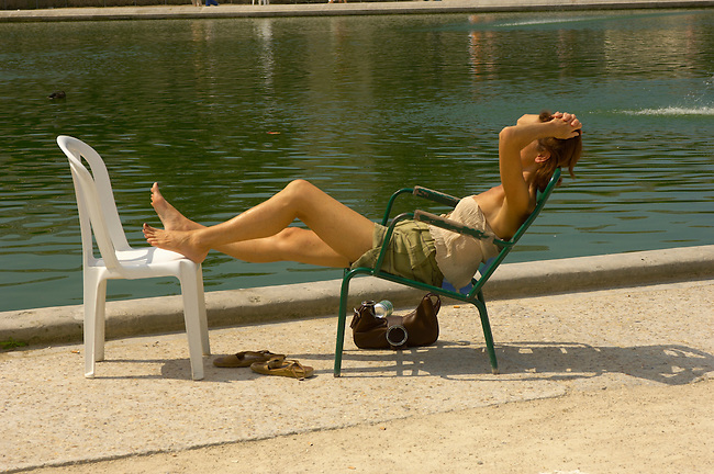 Paris - France -Jardin des Tuileries - women sunbathing.