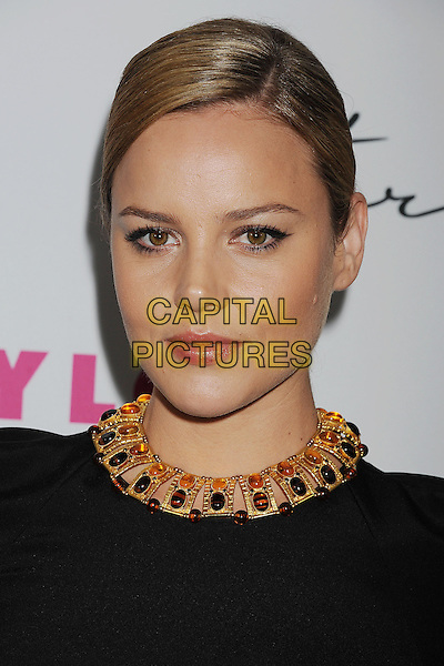 ABBIE CORNISH .arriving at NYLON Magazine's 12th Anniversary Issue Party With The Cast of Sucker Punch at Tru Hollywood in Hollywood, California, USA,.March 24th 2011. .portrait headshot black beauty gold necklace .CAP/ROT/TM.©TM/Roth Stock/Capital Pictures