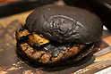 Burger King's new black burger ''Kuro Shogun'' went on sale on August 21, 2015, Tokyo, Japan. The chain's two new black burgers use bamboo charcoal-infused buns and cheese, Black Hashed Sauce (a mix of red wine, squid ink, onions, tomato and crushed garlic), and slices of grilled eggplant. In July Burger King launched two red burgers in another Japan only colored burgers promotion. The two new black burgers are the Kuro Shogun costing 690 JPY (5.59 USD) and the Kuro Taisho costing 590 JPY (4.78 USD). They will be on sale for a limited time in Burger King's Japanese stores from August 21st. (Photo by Rodrigo Reyes Marin/AFLO)