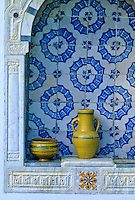 Tunisia, Sidi Bou Said.  Decorative Pottery in the Dar Annabi, a Private Home open for Public Viewing.  Originally constructed 18th. century, remodeled 20th. century.  The orange, black, and white tile is known as the Lion's Paw design.