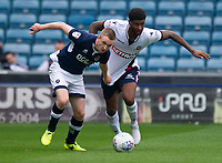 Millwall's Shane Ferguson holds off the challenge from Bolton Wanderers' Mark Little<br /> <br /> Photographer Ashley Western/CameraSport<br /> <br /> The EFL Sky Bet Championship - Millwall v Bolton Wanderers - Saturday August 12th 2017 - The Den - London<br /> <br /> World Copyright &not;&copy; 2017 CameraSport. All rights reserved. 43 Linden Ave. Countesthorpe. Leicester. England. LE8 5PG - Tel: +44 (0) 116 277 4147 - admin@camerasport.com - www.camerasport.com