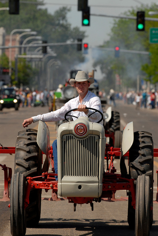 Tractors roll down Main Street at the Bucking Horse Sale parade in Miles City, Montana.