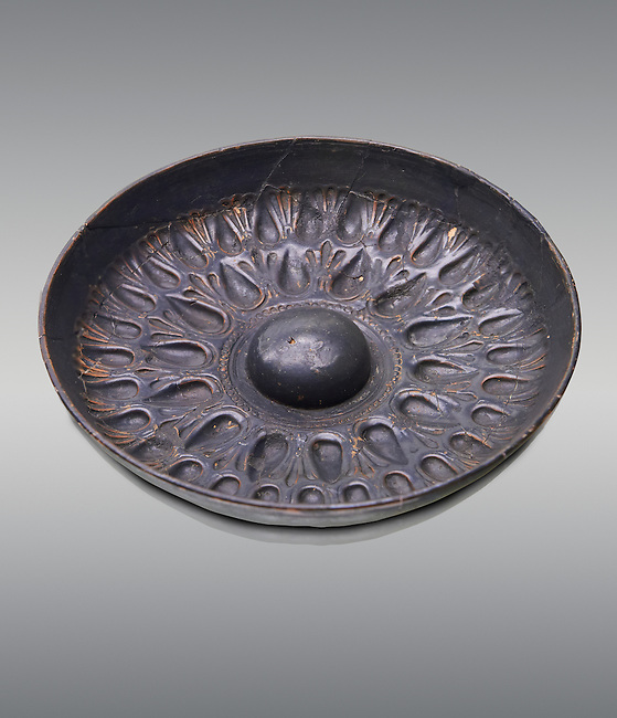 250 - 150 B.C Etruscan phiale or patera, or wine drinking bowl, produced in Calena,   National Archaeological Museum Florence, Italy , against grey