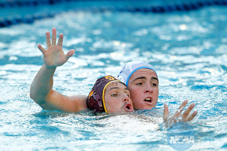04 DEC 2011:  Josh Samuels (23) of the University of California- Los Angeles and Jeremy Davie (2) of the University of Southern California muscle each other for position during the Division I Men's Water Polo Championship held at the Spieker Aquatics Center on the University of California- Berkeley campus in Berkeley, CA.  USC defeated UCLA 7-4 for the national title.  Jamie Schwaberow/NCAA Photos