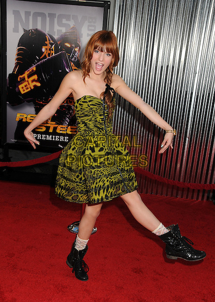 """Bella Thorne.""""Real Steel"""" Los Angeles Premiere Held at A Universal City Walk Cinemas, Hollywood, California, USA..October 2nd, 2011.full length black boots green leopard print dress strapless braid plait hands arms posing mouth open funny.CAP/ADM/KB.©Kevan Brooks/AdMedia/Capital Pictures...CAP/ADM/BP.©Byron Purvis/AdMedia/Capital Pictures."""