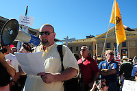 "Phoenix, Arizona. January 19, 2013 - Several speakers addressed the crowd during Saturday's rally on Phoenix. Gun owners mobilized on Saturday to protest proposed legislation on gun control. As President Barack Obama proposed new gun regulations last week, gun owners demonstrated against it with national ""Guns Across America"" rallies to defend the Second Amendment. Dozens showed up at the Arizona State Capitol, many of them carrying weapons. Photo by Eduardo Barraza © 2013"