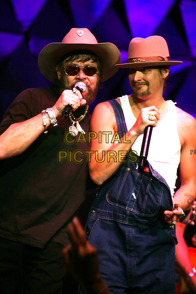 HANK WILLIAMS JR. & KID ROCK.The NFL Alumni Awards held at the Seminole Hard Rock,.Hollywood, Florida, USA, 2 February 2007..half length denim dungarees hat white vest performing live on stage concert gig.CAP/ADM/RR.©Randi Radcliff/AdMedia/Capital Pictures.