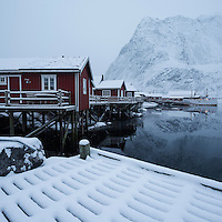 Traditional red Rorbu cabins in winter, Reine, Moskenesøy, Lofoten Islands, Norway