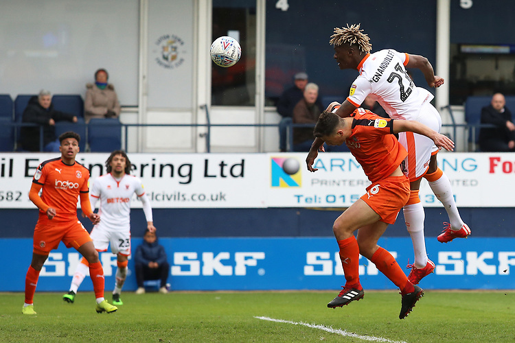 Blackpool's Armand Gnanduillet beats Luton Town's Matty Pearson in the air to aim a header towards goal<br /> <br /> Photographer David Shipman/CameraSport<br /> <br /> The EFL Sky Bet League One - Luton Town v Blackpool - Saturday 6th April 2019 - Kenilworth Road - Luton<br /> <br /> World Copyright © 2019 CameraSport. All rights reserved. 43 Linden Ave. Countesthorpe. Leicester. England. LE8 5PG - Tel: +44 (0) 116 277 4147 - admin@camerasport.com - www.camerasport.com