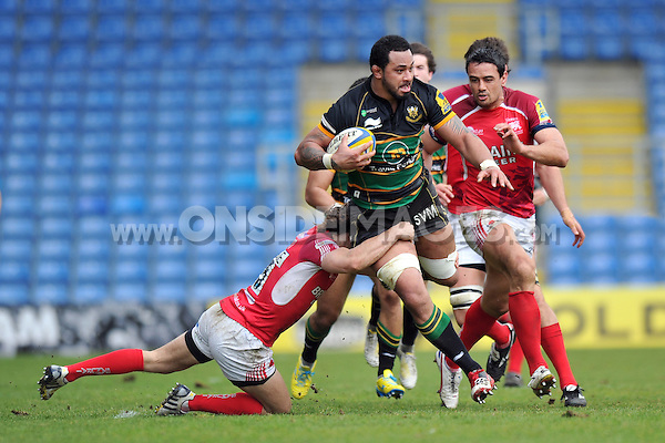 Samu Manoa is tackled in possession. Aviva Premiership match, between London Welsh and Northampton Saints on April 14, 2013 at the Kassam Stadium in Oxford, England. Photo by: Patrick Khachfe / Onside Images