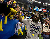 Michigan quarterback Denard Robinson celebrates with the fans after winning Sugar Bowl game against Virginia Tech at Mercedes-Benz SuperDome in New Orleans, Louisiana on January 3rd, 2012.  Michigan defeated Virginia Tech, 23-20 in overtime.
